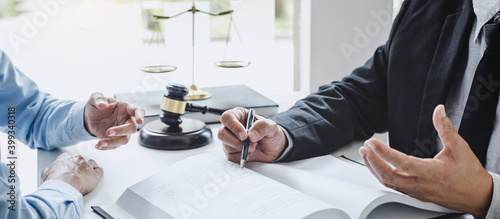 Fotografie, Tablou Consultation and conference of Male lawyers and professional businesswoman working and discussion having at law firm in office
