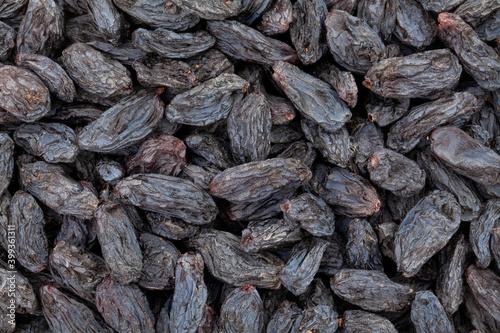 Fotografie, Obraz black raisins closeup texture background