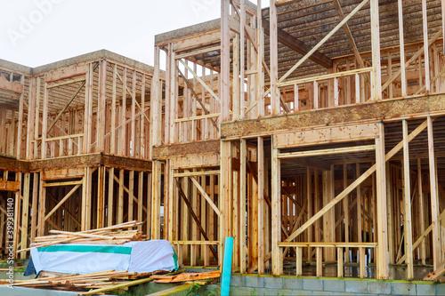 Fototapeta Framing home unfinished wood frame building or a house obraz