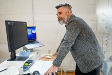 Startup Business Owner Working At Computer In Workspace