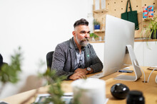 Startup Business Owner Working At Computer