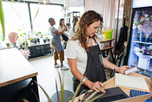 Owner Of Florist Startup Checking Online Orders On Digital Devices