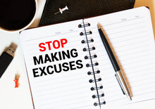 Stop Making Excuses Text Written On A Notebook With Pencils