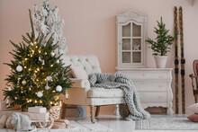 Armchair With Blanket Near Christmas Tree
