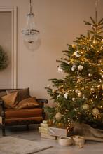 Christmas Tree And Presents Near Sofa