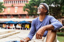 Senior Black Man Holding Smartphone.