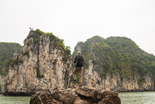 Man Standing On A Rock Contemplating Rocky Formations