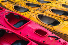 Group Of Yellow And Pink Canoes