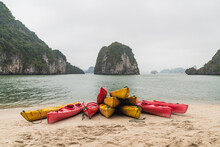 Canoes Piled Up On A White Sand Beach