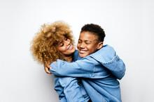 Black Boy In Studio Hugging His Mom.