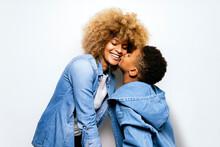 Black Boy In Studio Kissing His Mom.