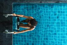 Black Skinned Girl By The Pool