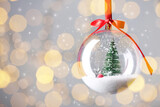 Fototapeta Kawa jest smaczna - Beautiful transparent Christmas ornament against blurred festive lights, bokeh effect. Space for text
