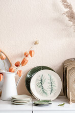 Artisan Crockery And Flowers On Table