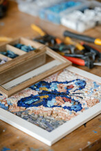 Butterfly Mosaic On Table In Workshop