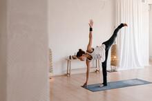 Slim Woman Doing Balance Yoga Exercise