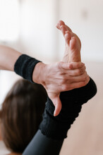 Unrecognizable Female Stretching Leg During Yoga Lesson