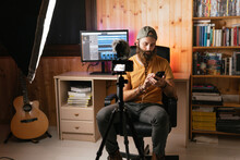 Man Making A Video Indoors
