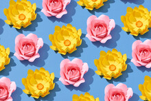 Floral Arrangement Of Paper Flowers On A Blue Background