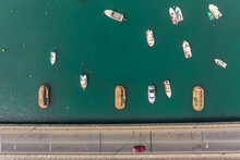 Aerial View Of Boats Anchored On The River Near A Bridge That Connects To Isla Cristina, Huelva, Spain.