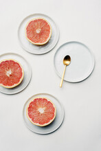 Styled Pink Grapefruit With Gold Spoon
