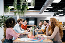 Portrait Of Coworkers Working Together In Office