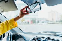 Woman's Hand Adjusting Car Mirror