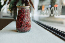 Jar Full Of Grain On Window Sill In Cafe