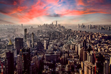 Aerial View Of New York City Against Orange Sky During Sunset, New York, USA