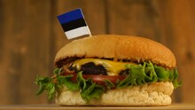 Delicious Burger With Small Estonian Flag On Top Of Them With Toothpicks. Yummy