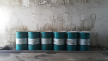 Dirty Greasy Barrels Outside Building With Grease Barrels.Disposed Used  Oil On Cover Of Barrel And Spillage On Floor