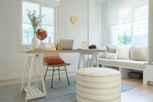Stylish And Boho Home Interior Of Open Work Space With Wooden Desk, Chair, Lamp, Laptop And White Shelf.