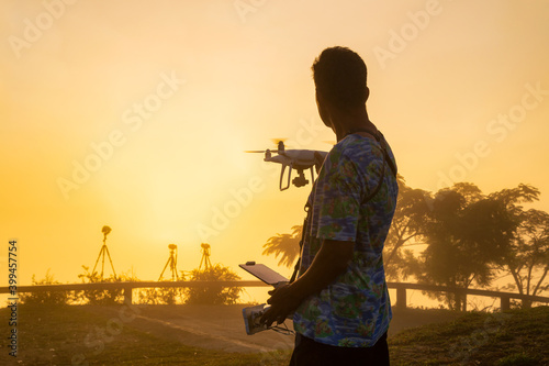 Fotografia Professional drone pilot or stock photographer playing with the drone