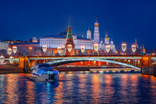Motor Ship In Center Of Moscow. Christmas In Russia. Panorama Of New Year's Kremlin Embankment. Great Kremlin Palace On A Winter Night. Water Travel On Night Before Christmas. Guided Tours In Moscow.