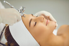 Smiling Womans Face Getting Oxygen Therapy Or Jet Peeling From Cosmetologist