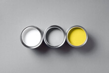 Open Paint Cans On Grey Background. Appartment Renovation, Repair, Building, Design Concept. Demonstrating Trendy Color Of The Year 2021. Illuminating Yellow And Ultimate Gray. Duotone
