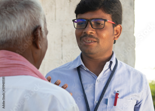 Fotografija Banker or corporate officer angry on farmer due to delay loan or debt repayment - Concept of crop loss and farm loan probelmes of Indian agricultural sector