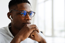 Close Up Shot Of Attractive Pensive African Man