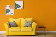 Stylish Interior Of Living Room With Colorful Sofa, Table And Pictures
