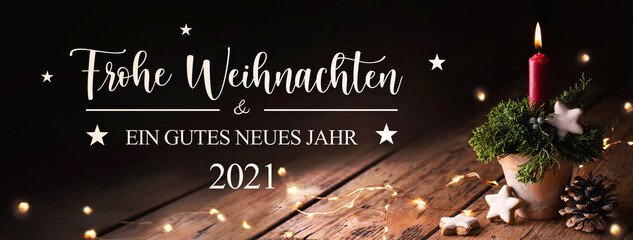 Christmas decoration with burning candle on rustic wood  -  Merry Christmas and Happy New Year 2021 in German language  -  Greeting Card, Christmas Card, Banner format
