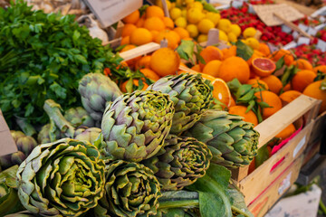 Close up view of green artichokes at local farmers market in Sicily