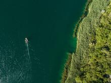 Aerial View Of Boat On Bacina Fresh Water Lakes In South Dalmatia, Croatia.