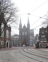Misty Street View Spui Square In Amsterdam With Church On The Background