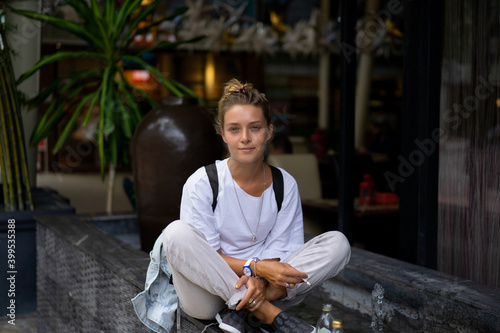 Fototapety, obrazy: Young woman traveler freelancer in a cafe.