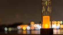 Candle Lamp Decoration With Candlelight On Table Near River Riverside And Bokeh Night Light As Background With Copyspace For Christmas Festive Decor Backdrop