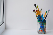 Paint Brushes In A Glass Jar. Painting Brushes On White Background