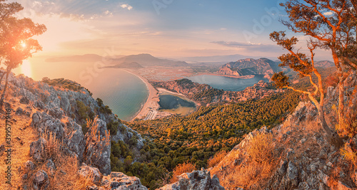 Fototapeta Stunning panoramic view from the top of the mountain to the blue bay and lagoon near the town of Dalyan in Turkey. Famous Mediterranean resorts and the wonders of nature obraz