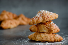Close Up Of Pile Of Delicious Croissants On A Dark Background. Homemade Croissants. Sugar Glass.