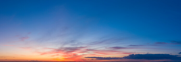 Dawn or sunset over the clouds, blue hour, aerial view.