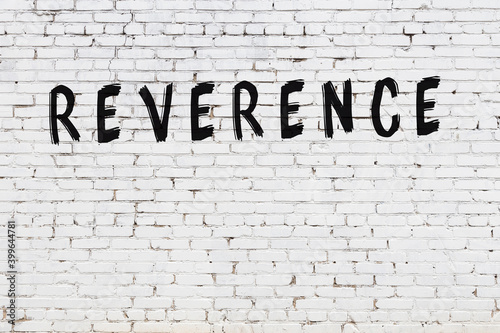 Papel de parede Inscription reverence painted on white brick wall
